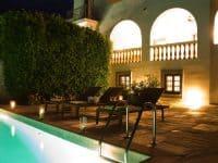 Villa-Corinna-Spetses-by-Olive-Villa-Rentals-pool-area-night-lights