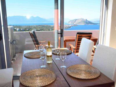 Villa Iris in Aegina Greece, dining table, by Olive Villa Rentals